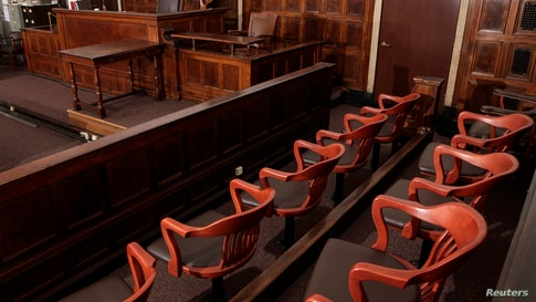 FILE -- A view of the jury box (front), where jurors would sit in and look towards the judge's chair (C), the witness stand (R) at the New York Supreme Court.