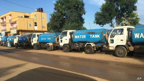 In this photo of Sunday Oct. 1, 2017, trucks wait in line for days at a petrol station in South Sudan's capital of Juba. The…