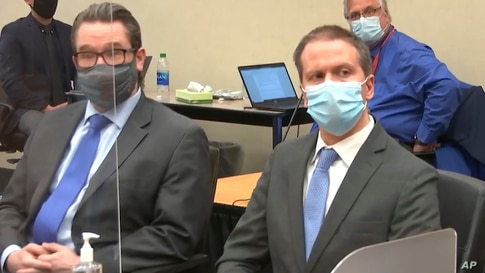 In this image from video, defense attorney Eric Nelson, left, and defendant, former Minneapolis police Officer Derek Chauvin.