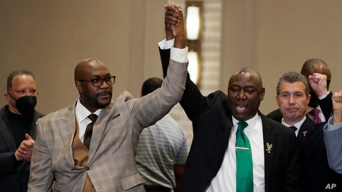 Philonise Floyd, left, and attorney Ben Crump react during a news conference after the guilty verdict was read in the trial of…