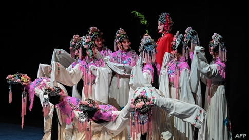 Actresses on stage during the performance of 'The Peony Pavilion', also called 'The Return of Soul' play at the Shanghai Grand Theater, in Shanghai, China, April 25, 2021.