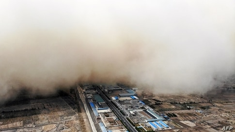 A sandstorm engulfs a village in Linze county, in the city of Zhangye in China's northwestern Gansu province.