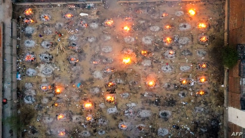In this aerial picture burning pyres of victims who lost their lives due to the Covid-19 coronavirus are seen at a cremation ground in New Delhi, India.