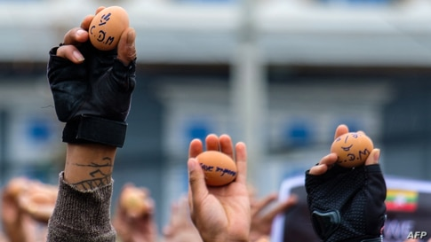 Protesters holding eggs with messages to coincide with Easter Sunday during a demonstration against the military coup in Taunggyi in Myanmar's Shan state.