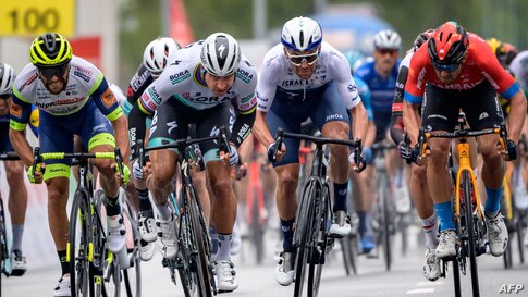 Peter Sagan of Slovakia (2ndL) sprints to win at the arrival of the stage 2, 168.1 km from Aigle to Martigny during the Tour de Romandie UCI World Tour 2021 cycling race in Martigny, Switzerland.