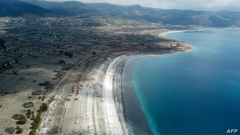 NASA believes the southwestern Turkey Salda Lake could offer clues to a crater on Mars but environmental activists fear the natural phenomenon with its bright white sand and sparkling turquoise waters is at risk.