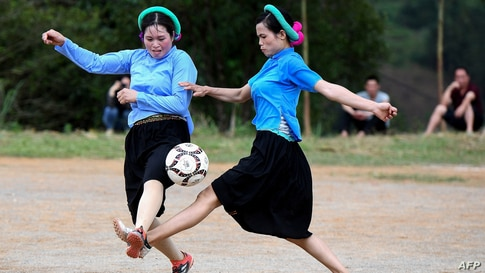 Ethnic San Chi women dressed in traditional costumes play a friendly football match as part of the Soong Co festival celebrations in northern Vietnam's Quang Ninh province.