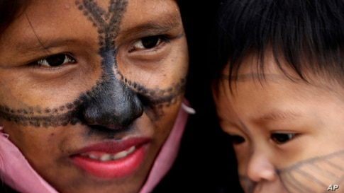 A Munduruku Indigenous woman and child from Alto Tapajos in the Brazilian state of Para attend a show of support for a government decree legalizing mining on Indigenous land outside the Supreme Court in Brasilia.