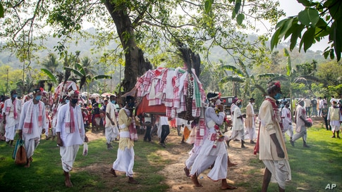 Villagers participate in a religious procession during the traditional Gohain Uliuwa Mela in Mayong village, about 50 kilometers (31 miles) east of Gauhati, India.
