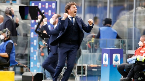 Inter Milan's head coach Antonio Conte celebrates his side's 1-0 win at the end of the Serie A soccer match between Inter Milan and Hellas Verona, at the San Siro stadium in Milan, Italy.