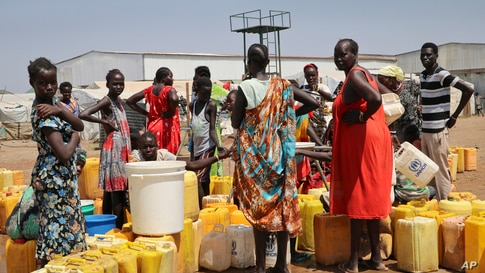 FILE - Residents of the Mangateen Camp for the internally displaced line up for water from a borehole, on the outskirts of the capital Juba, South Sudan, Jan. 22, 2019.