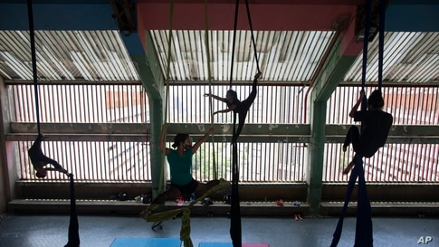 Members of the Multidisciplinary Circus Nuevo Karakara practice aerial acrobatics after the COVID-19 lockdown was eased in Caracas, Venezuela, April 27, 2021.