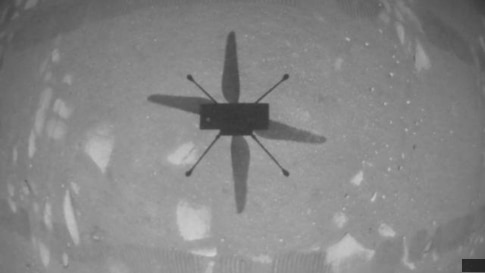 NASA's Ingenuity Mars Helicopter captured this shot as it hovered over the Martian surface on April 19, 2021, during the first instance of powered, controlled flight on another planet.