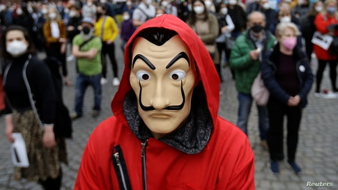 A demonstrator wearing a Salvador Dali mask attends an anti-government protest in Prague, Czech Republic.