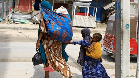 Civilians flee following gunfire between factions within Somalia's security forces near KM4 in Hodan district of Mogadishu, Somalia.