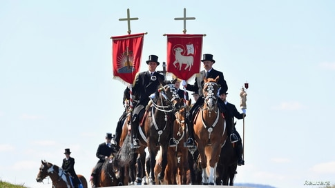 Sorbian men dressed in black tailcoats ride decorated horses during an Easter rider procession near Crostwitz, Germany.