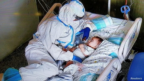 A nurse comforts a seven-month-old baby after an operation at the Salesi Hospital in Ancona, Italy.