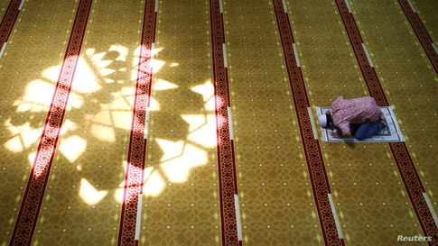 A Muslim man prays at a mosque during the holy fasting month of Ramadan in Shah Alam, Malaysia.