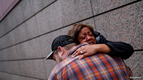People react after the verdict in the trial of former Minneapolis police officer Derek Chauvin, found guilty of the death of George Floyd, in front of Hennepin County Government Center, in Minneapolis, Minnesota, April 20, 2021.