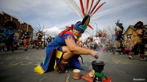 The Kalpulli Ketzalcoatlicue and Kalpulli Tlaloctecuhtli dance groups perform at George Floyd Square during the People's Power Love Fest in Minneapolis, Minnesota,  April 4, 2021.