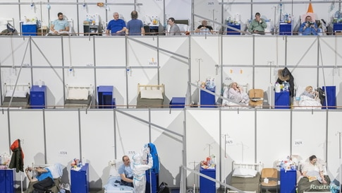 Patients suffering from the COVID-19 lay in beds at the Stark Arena sports venue that is turned into a COVID hospital in Belgrade, Serbia.