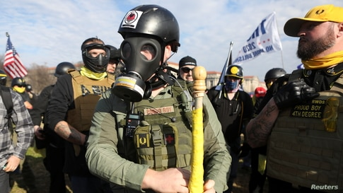 FILE - Supporters of U.S. President Donald Trump along with members of the far-right group Proud Boys gather for a rally to protest the results of the election, in Washington, Dec. 12, 2020.