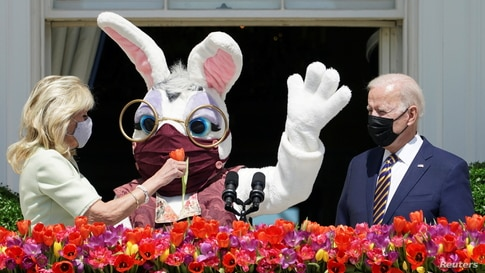 U.S. President Joe Biden, first lady Jill Biden and a person wearing an Easter Bunny costume are see on the Blue Room Balcony of the White House in Washington.