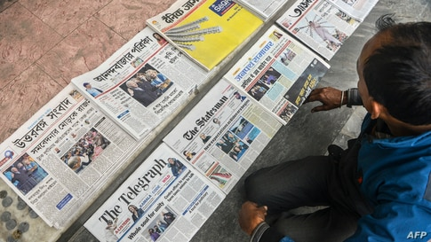 A vendor arranges newspapers featuring front-page news on US President Joe Biden and Vice President Kamala Harris in Siliguri…