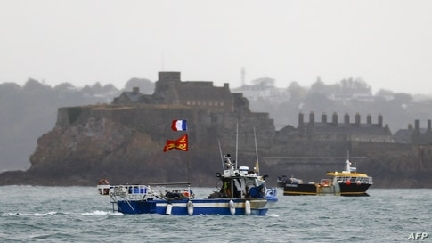 ALTERNATIVE CROP - French fishing boats protest in front of the port of Saint Helier off the British island of Jersey to draw…