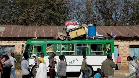FILE - A bus carrying displaced people arrives at the Tsehaye primary school, which was turned into a temporary shelter for people displaced by conflict, in the town of Shire, Tigray region, Ethiopia, March 14, 2021