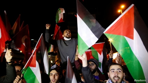 Pro-Palestinian demonstrators shout slogans during a protest against Israel near the Israeli Consulate in Istanbul, Turkey late…