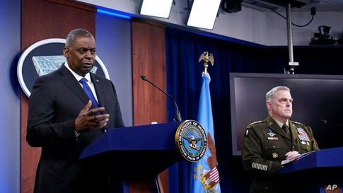 Defense Secretary Lloyd Austin, left, and Chairman of the Joint Chiefs of Staff Gen. Mark Milley, right, participate in a…
