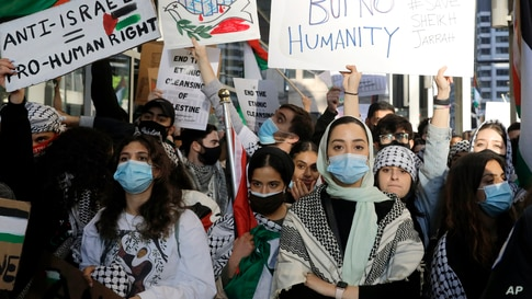 Hundreds of protesters gather and protest in support of Palestinians in front of the Consulate General of Israel in Chicago.