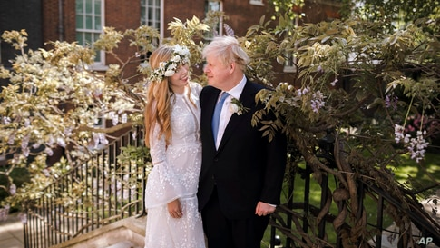 Downing Street handout photo of Prime Minister Boris Johnson and Carrie Johnson in the garden of 10 Downing Street after their…