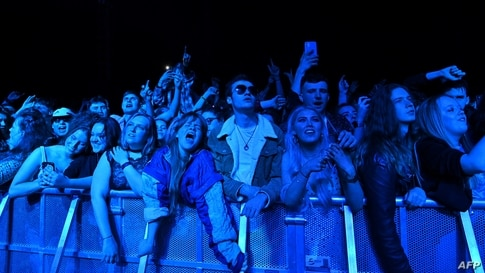 Fans watch Blossom perform at a live music concert hosted by Festival Republic in Sefton Park in Liverpool, north-west England, May 2, 2021, where a non-socially-distanced crowd of 5,000 are expected to attend.