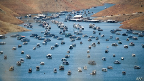Houseboats are moored on Lake Oroville reservoir during the California drought emergency on in Oroville.