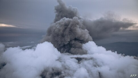 This aerial photo shows the column of ash expelled from the crater of Nyiragongo volcano, north of Goma, the provincial capital of North Kivu, Democratic Republic of Congo, May 30, 2021.