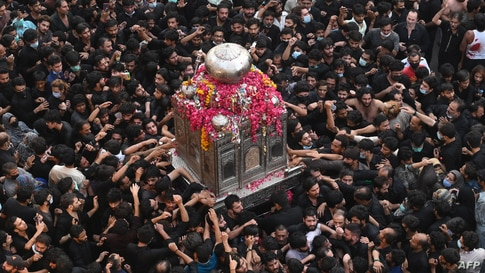 Shi'ite Muslim devotees take part in a procession to commemorate the death anniversary of Prophet Mohammad's companion and son-in-law Imam Ali in Lahore, Pakistan.