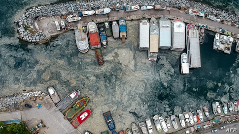 This aerial photograph taken on May 30, 2021 shows mucilage, a thick, viscous fluid produced by phytoplankton, in Turkey's Marmara Sea at a harbor on the shoreline of Istanbul.