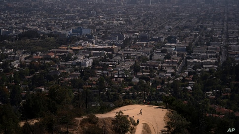 A jogger runs along a Griffith Park trail in Los Angeles, California, May 3, 2021.