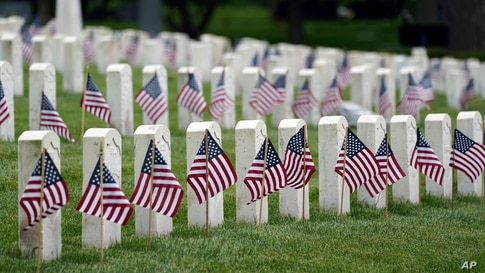 American flags are displayed next to veterans' graves ahead of Memorial Day at the Crown Hill National Cemetery in Indianapolis, May 29, 2021.