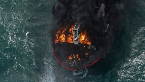 In this photo provided by Sri Lanka Air Force, smoke rises from the container vessel MV X-Press Pearl engulfed in flames off Colombo port.