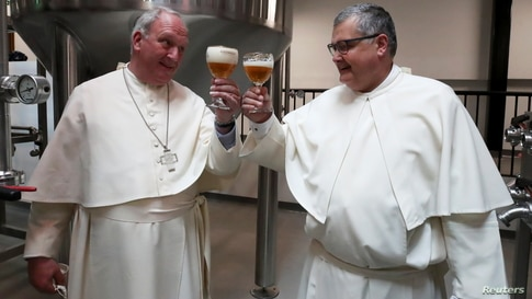 Father Karel Stautemas and abbot Erik toast after blessing beer tanks at the Belgian Abbey of Grimbergen, which returns to brewing after a break of more than 200 years with a new microbrewery in Grimbergen, Belgium, May 26, 2021.