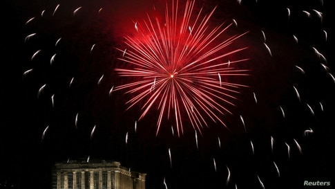 Fireworks explode over the Parthenon temple to celebrate the Greek Orthodox Easter, amid the COVID-19 outbreak, in Athens, Greece, May 1, 2021.