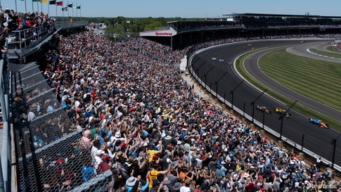 Spectators react as drivers take their first lap at the Indy 500, the largest attended sporting event since the start of the coronavirus disease (COVID-19) pandemic, in Indianapolis, Indiana, May 30, 2021.