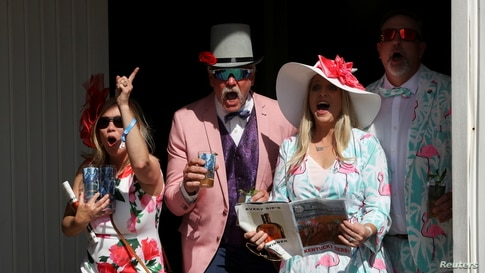 Spectators cheer for their winning horse at Churchill Downs on the day of the 147th Kentucky Derby in Louisville, Kentucky, May 1, 2021.