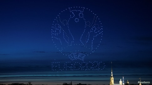 Drones forming a logo of the UEFA Euro Cup 2020 light up the sky over the Cathedral of St. Peter and St. Paul in Saint Petersburg, Russia May 2, 2021.