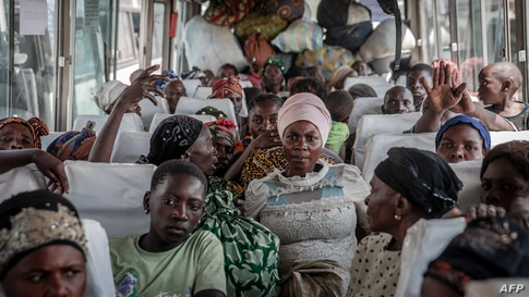 Displaced people who fled Goma after the eruption of the Nyiragongo volcano wait on a bus in Sake with their belongings,…