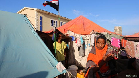 Yemeni refugee stands in front of their makeshift shelter at a temporary camp in Somalia's capital Mogadishu, December 16, 2015…