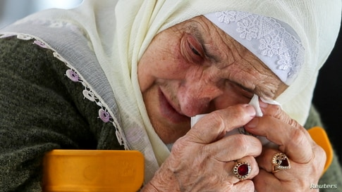 A Bosnian Muslim woman reacts as she awaits the final verdict of former Bosnian Serb military leader Ratko Mladic in the…